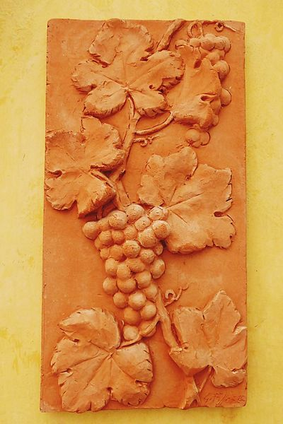 Italy🇮🇹 Barolo City Barolo Wineyards Balcony Shot Street Photography Wall Art Wall Decoration Wall Decor Grapes 🍇 Terracotta Clay Work Clayart Outdoor Photography Fine Art Fine Art Photograhy Warm Colors Taking You On My Journey 😎 Historical Building History Architecture Details Of My Life Color Palette Colour Of Life Winegrapes Wine Country No People