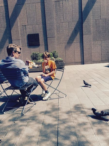 Up Close Street Photography NYC Photography Tourists Fatherandson Sharing Meal Withpigeons