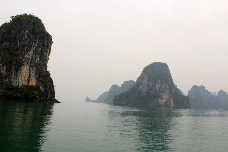 Rock Formations On Halong Bay Against Clear Sky