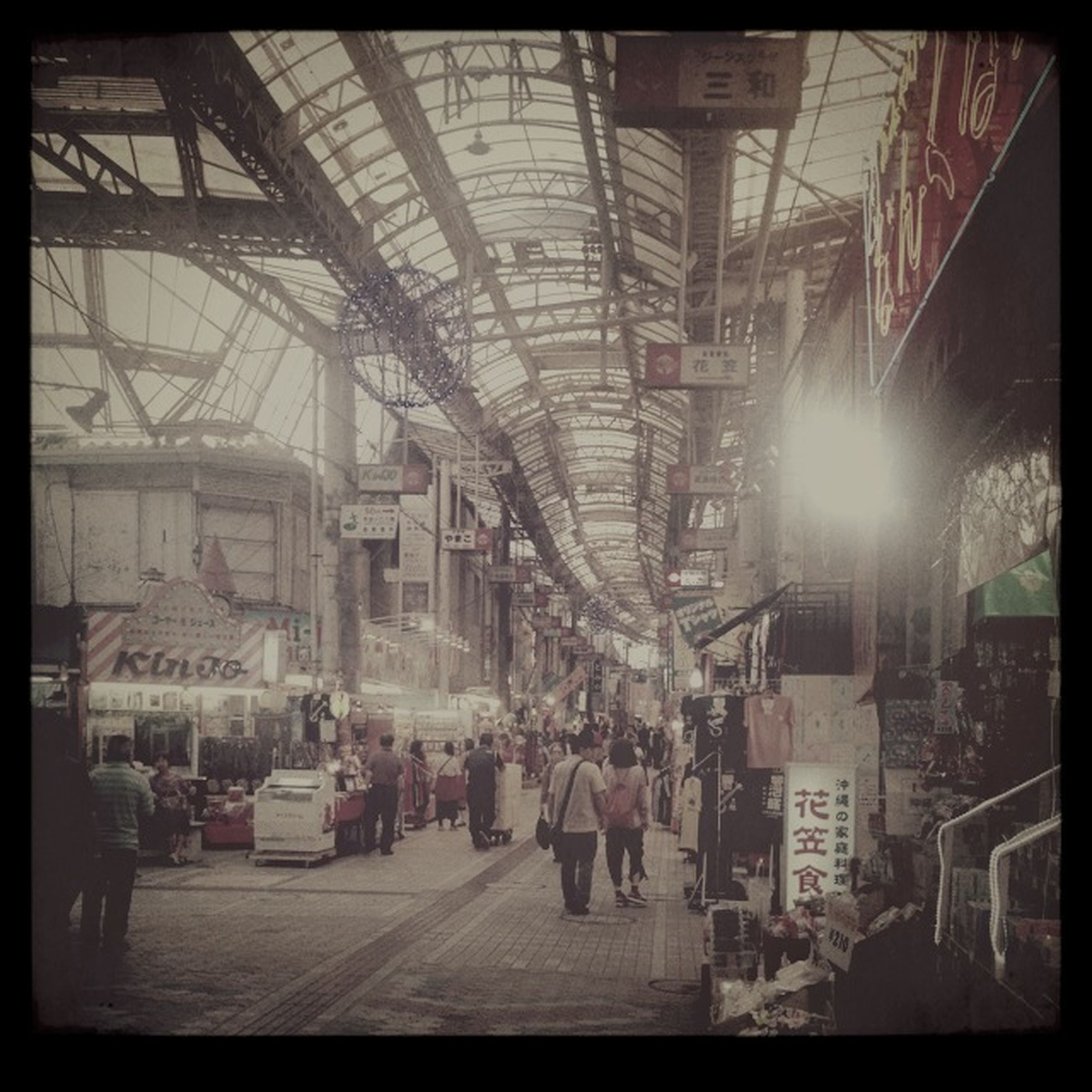 transfer print, auto post production filter, architecture, built structure, indoors, large group of people, building exterior, men, city, city life, person, railroad station, lifestyles, transportation, walking, public transportation, travel, incidental people, ceiling