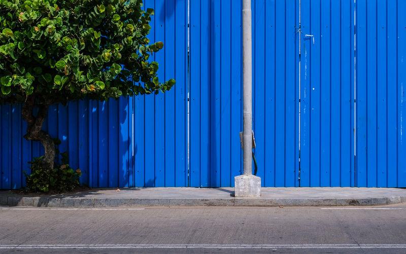 Closed metal gate against blue sky