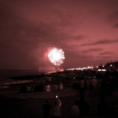 Fireworks on the Beach Armed Forces Day Celebration Firework Display Outdoors Exploding Fireworks Sky Sky And Clouds Large Group Of People Seafront View People Crowd Night Celebration