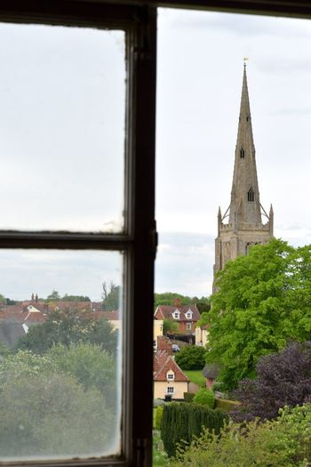 Looking through window towards large village church Christian Essex Norman Thaxted Architecture Belief Building Building Exterior Place Of Worship Religion Spire  Spirituality Village Village Life Window Windows