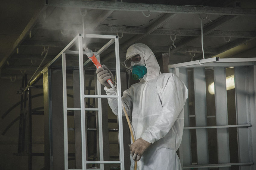 Paint work Adult Adults Only Business Finance And Industry Hygiene Indoors  Industry Lab Coat Laboratory Occupation Occupational Safety And Health One Person People Protection Protective Glove Protective Mask - Workwear Protective Workwear Scientist Spray Bottle Technology Three Quarter Length Working