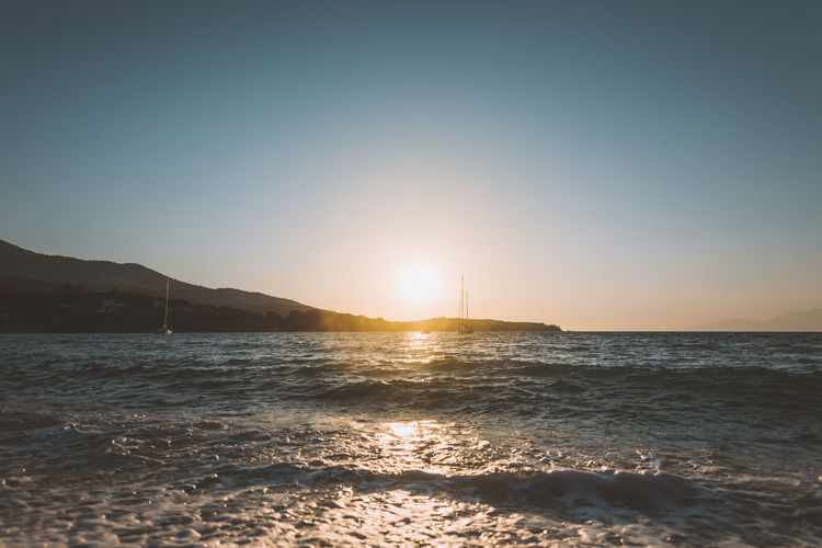 Lost In The Landscape Beach Beauty In Nature Clear Sky Day Horizon Over Water Lens Flare Mountain Nature No People Outdoors Scenics Sea Sky Sun Sunlight Sunset Tranquil Scene Tranquility Water Waterfront Wave