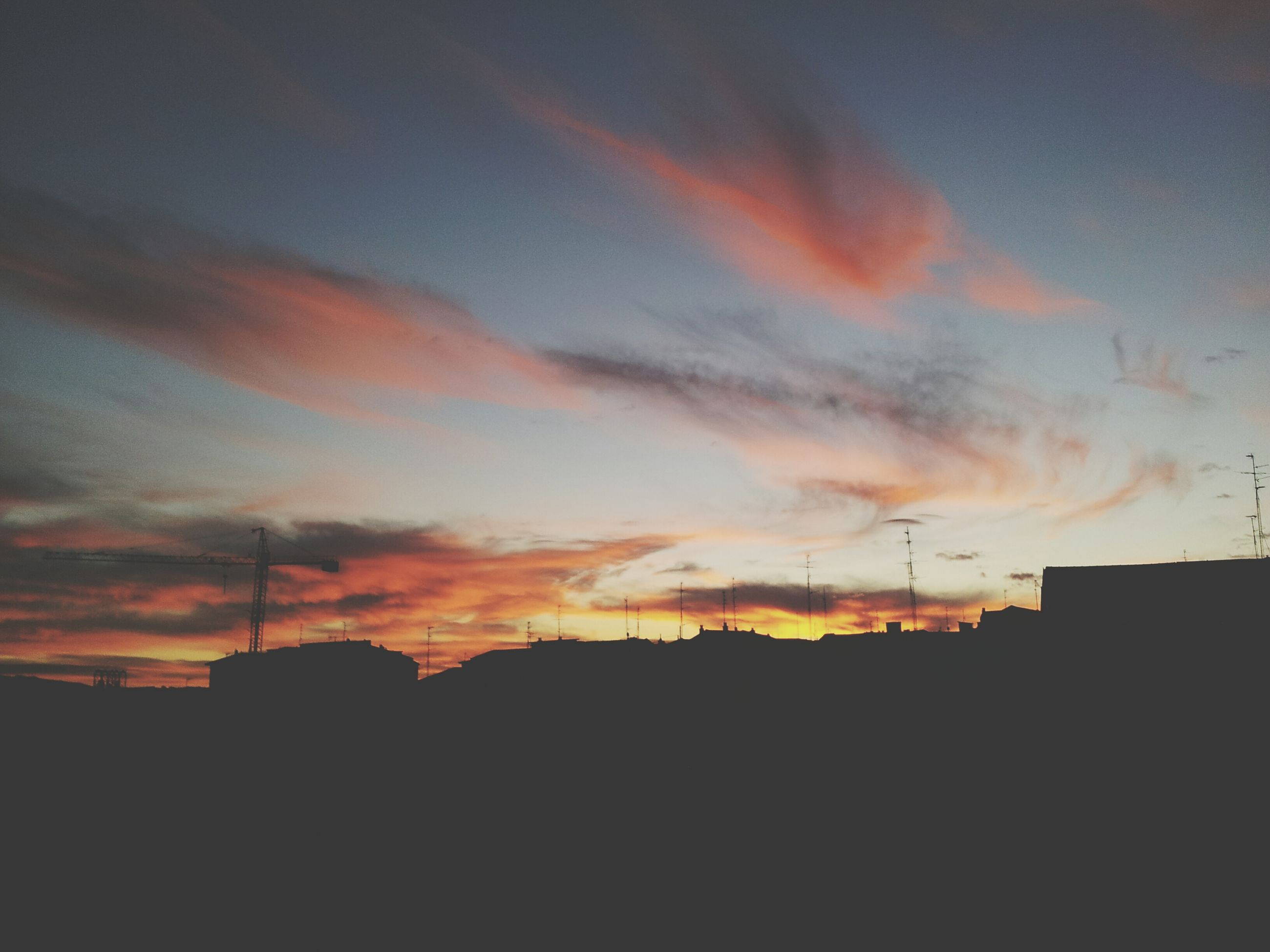 sunset, silhouette, orange color, sky, building exterior, built structure, architecture, cloud - sky, low angle view, beauty in nature, dramatic sky, nature, scenics, dusk, cloud, outdoors, city, no people, dark, building