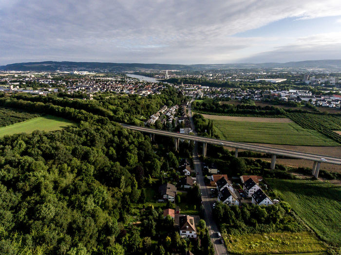 Aerial view of surroundings and village of Andernach in Germany on a sunny summer day with blue sky Architecture Building Exterior Built Structure Plant City Sky High Angle View Residential District Building Nature Tree Environment Cloud - Sky Day Landscape Green Color Cityscape Outdoors Grass Land No People Kettig Andernach Aerial View Drone