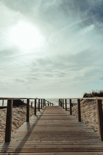 Direction Sky Wood - Material Sea The Way Forward Pier Water Nature Horizon Architecture Horizon Over Water Built Structure Wood Cloud - Sky Outdoors Tranquility Railing Diminishing Perspective No People Freedom Wood Paneling Long Summer Beach Sun