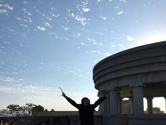 拔草之娛 Sky Real People Leisure Activity Architecture Built Structure Lifestyles Outdoors Day Nature Standing Men Human Arm Cloud - Sky Architectural Column Silhouette Building Exterior Gesturing Arms Raised Excitement First Eyeem Photo