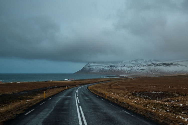 Road Sky Cloud - Sky Transportation Beauty In Nature Environment Scenics - Nature Storm Direction Landscape Water Nature Tranquil Scene The Way Forward Non-urban Scene No People vanishing point Overcast Day Diminishing Perspective Outdoors Iceland
