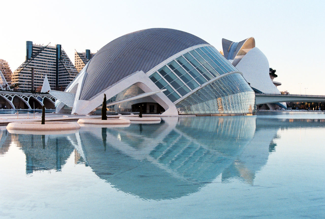 reflection, architecture, built structure, water, building exterior, modern, clear sky, waterfront, swimming pool, no people, outdoors, dome, day, city, sky