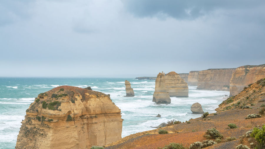 Scenic view at the Twelve Apostles National Park Beach Beauty In Nature Cliff Cloud - Sky Day Horizon Horizon Over Water Land Limestone Rocks Nature Outdoors Rock Rock - Object Rock Formation Scenics - Nature Sea Sky Solid Stack Rock Storm Cloud Tranquil Scene Tranquility Water Waves, Ocean, Nature