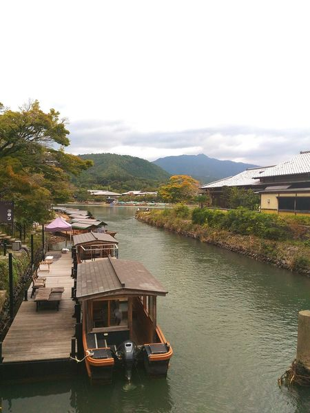Water Architecture Built Structure Transportation Building Exterior River Cloud - Sky Tree Sky Waterfront Day Cloudy Mountain Outdoors Mountain Range Canal Scenics Town No People Tranquil Scene Arashimaya Japan Tourism Travel Destinations The Culture Of The Holidays