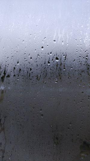 Full frame shot of raindrops on window