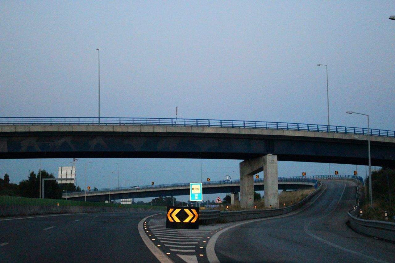 bridge - man made structure, transportation, connection, road, highway, architecture, day, built structure, land vehicle, clear sky, car, road sign, outdoors, no people, nature, sky