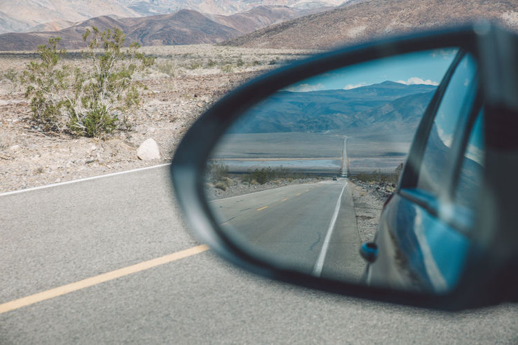 Reflection of road on side-view mirror