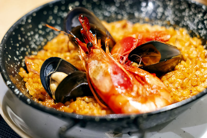 Paella with mariscos in a black pan, a typical dish of traditional spanish cuisine
