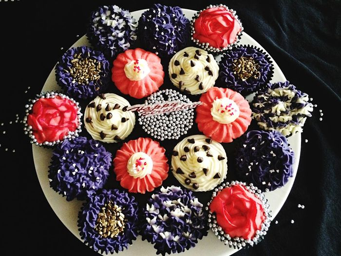 Top view of variety of cupcakes on plate