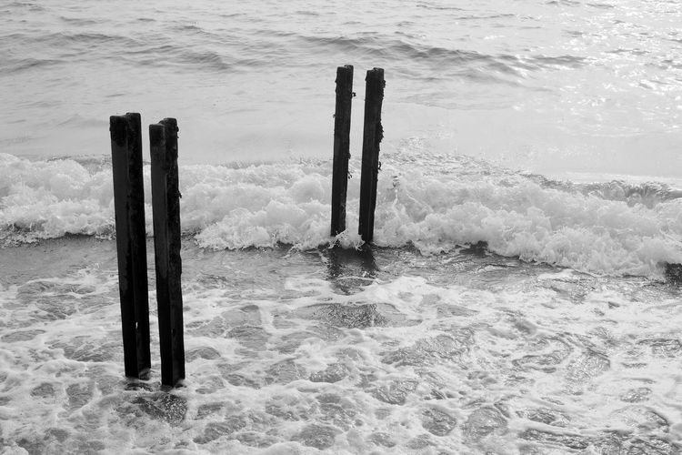 Tattered Remnants Sea Water Wave Waterfront Post Motion Beauty In Nature Beach Blackandwhite Black And White