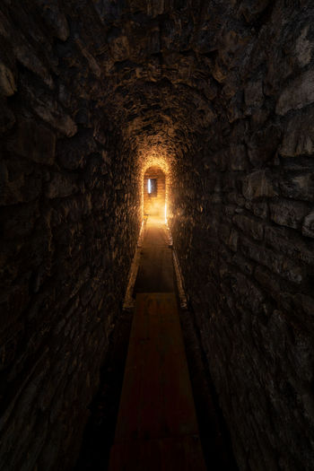 Illuminated tunnel in building