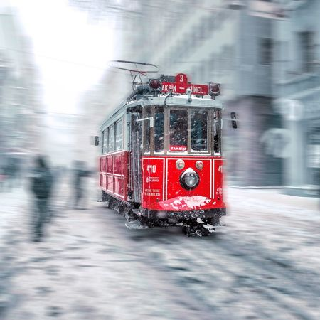 In winter,Nostalgic tramway goes at istiklal street,a popular street in Istanbul,Turkey Nostalgic  Tramway Tramway Rail Retro Istiklalcaddesi Istiklal Caddesi Istiklal Street Istanbul Turkey Taksim Taksimbeyoglu Winter Snowy Cityscape Travel Destinations Destination Popular Daytime Blurred Motion Motion Blur Historical Sky Turquoise Red Blurred Motion Mode Of Transport Street Speed Road
