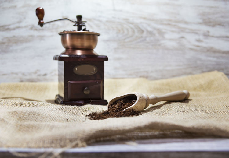 Vintage wooden grinder, coffee beans and milling coffee on rustic background with copy space Still Life Indoors  No People Coffee Background Texture Wallpaper Rustic Beans Aroma Caffeine Grinder Mill Vintage Copy Space Drink Expresso  Capuccino Tasty Brown Selective Focus Retro Lifestyles Beverage Roasted