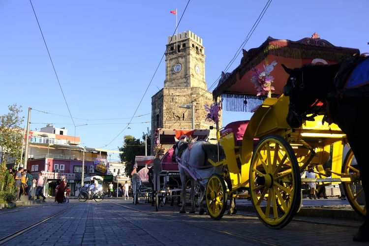 The old clock tower and its surrounding in the center of Antalya Turkey Türkei Antalya Clock Tower Uhrturm Kaleiçi Horse Carriage Pferdekutsche