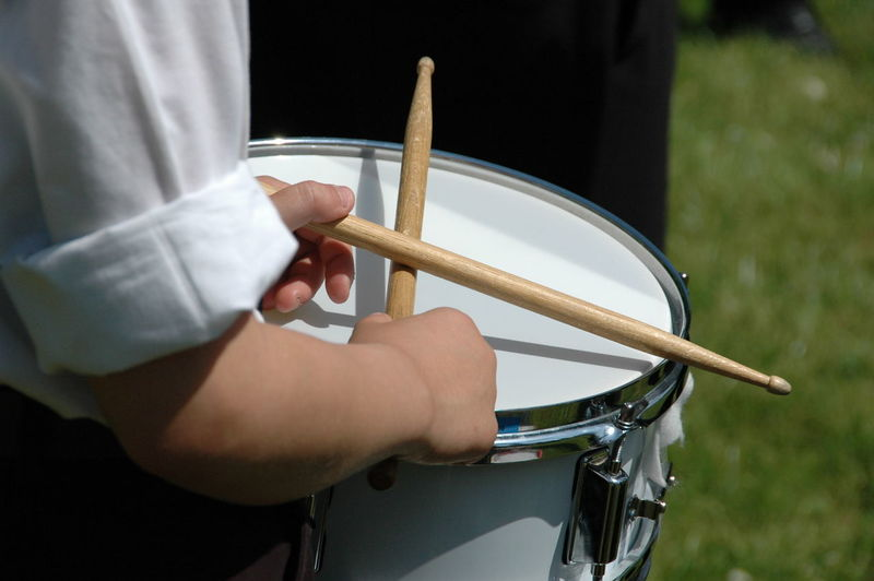 Midsection Of Person Playing Drum