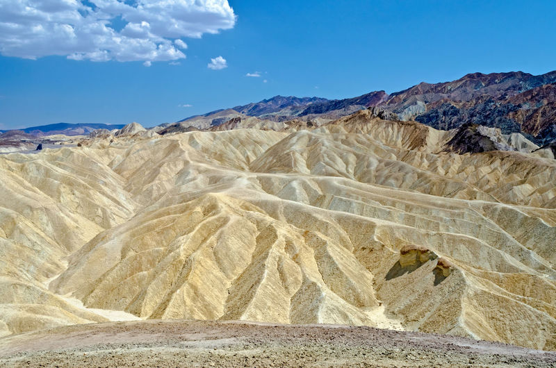 Zabriskie Point, scenic place in Death Valley, California, USA Arid Climate Beauty In Nature Climate Cloud - Sky Day Desert Environment Land Landscape Mountain Mountain Range Nature No People Non-urban Scene Outdoors Physical Geography Remote Salt Flat Scenics - Nature Sky Tranquil Scene Tranquility