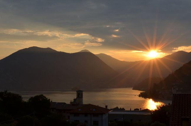 Italia Lago D'Iseo Atmospheric Mood Cloud - Sky Italy Lake Lake View Mountain No People Silhouette Sky Sulzano Sun Sunbeam Sunlight Sunset Water