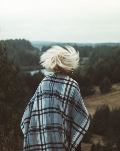 Rear View Real People One Person Leisure Activity Nature Focus On Foreground Lifestyles Blond Hair Standing Day Casual Clothing Outdoors Sky Women Tree Scenics Landscape Young Women Young Adult Beauty In Nature