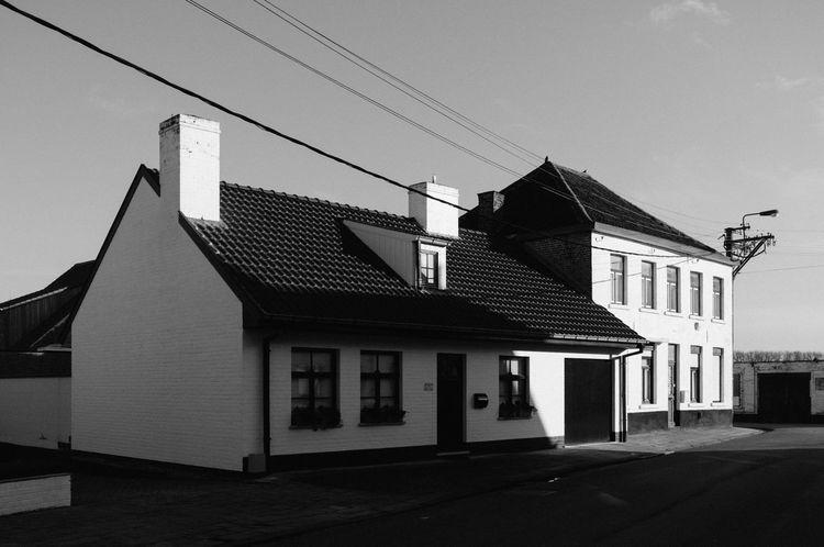 Little village Oostkerke, near Zeebrugge, Bruges and Damme. Blackandwhite Flanders Powerlines Solitary House West Vlaanderen West-Vlaams Westtoer White Houses Wintersun