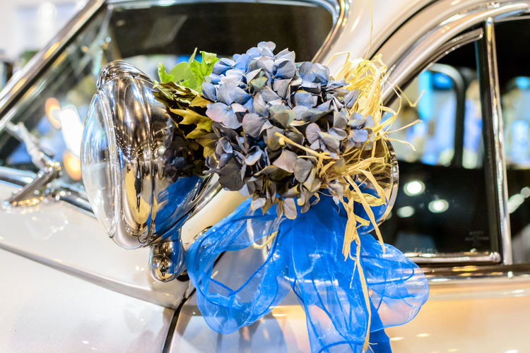 View of bridal bouquet of flowers attached to the side of a white car. Beautiful Bouquet Bridal Bridal Bouquet Close-up Floral Flower Marital Marriage  Matrimonial Nuptial Wedding