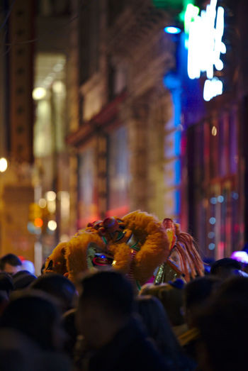 Philadelphians celebrate the Year of the Rooster with Chinese lion dances, fire crackers and more. Architecture Built Structure China Town Phil Chinatown Chinese New Year Chinese New Year 2016 Chinese New Year 2017 City Color Colorful Crowd Illuminated Large Group Of People Light Night Night Photography Outdoors People People Watching Philadelphia Rear View