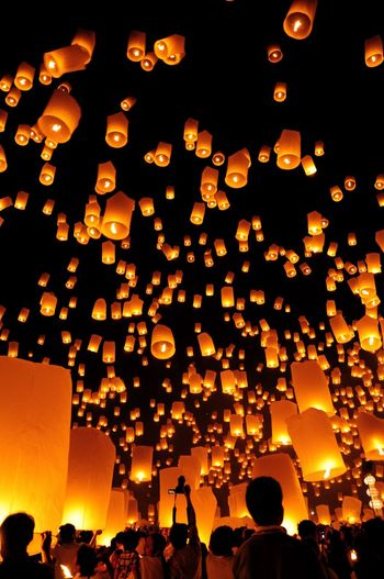 Lanterns Illuminated Lighting Equipment Chinese Lantern Festival Traditional Festival Sky Cultures Large Group Of Objects Paper Lantern Low Angle View Night Loykrathong Festival Chiang Mai | Thailand