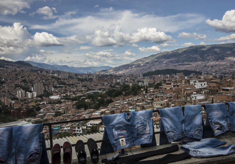 High Angle View Of Jeans Drying On Clothesline Against Cityscape