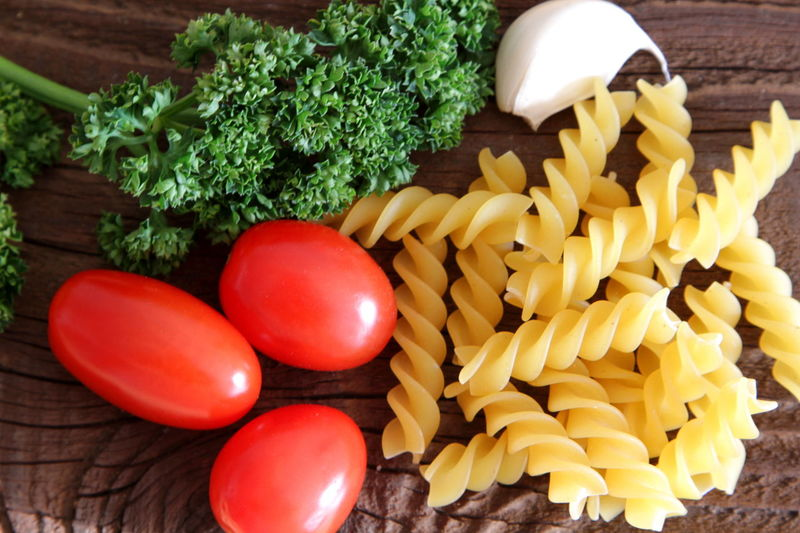 Fusilli Wood Backgrounds Close-up Food Food And Drink Freshness Fusilli Pasta Healthy Eating Indoors  Italian Food No People Penne Penne Pasta Raw Food Raw Pasta Wooden Background