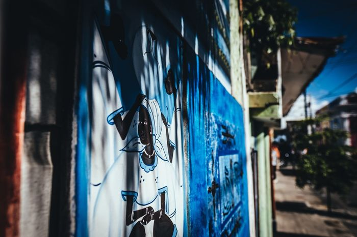 Art is Everywhere Sunny Summer Wallart Travel Photography Travel Destinations Colorful Fujifilm_xseries Photographyisthemuse Streetphotography Art Hanging Building Exterior Blue Architecture Built Structure No People Outdoors Day Close-up