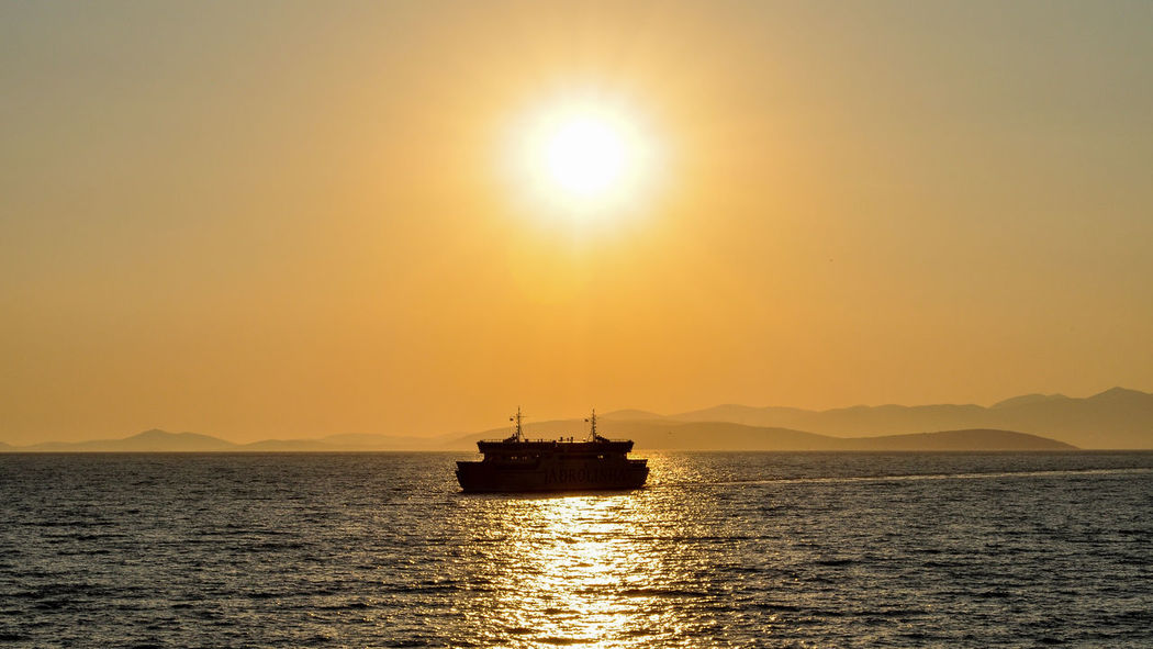Beauty In Nature Day Nature Nautical Vessel No People Offshore Platform Outdoors Sailing Scenics Sea Shadow Ship Silhouette Sky Sun Sunlight Sunset Sunset Silhouettes Sunset_collection Transportation Water Waterfront