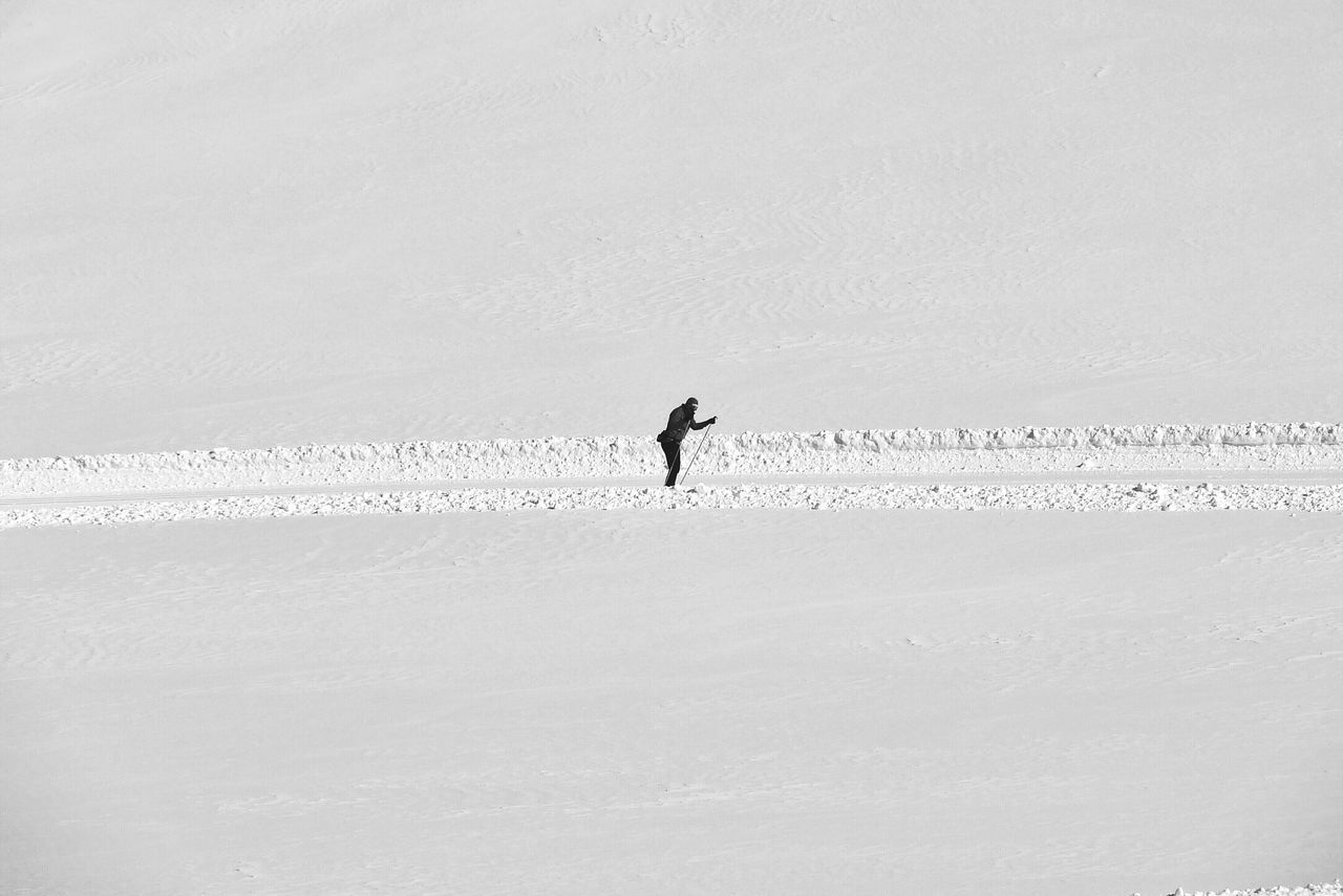 Person skiing in snow covered landscape