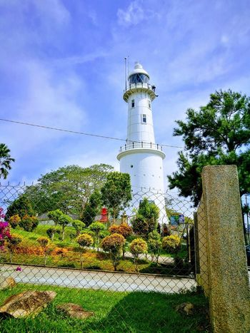 A historic lighthouse Lighthouse Cloud - Sky No People Outdoors Sky Historical Monuments Perspectives On Nature