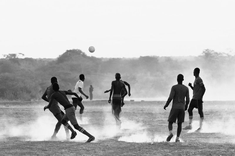People playing soccer on field