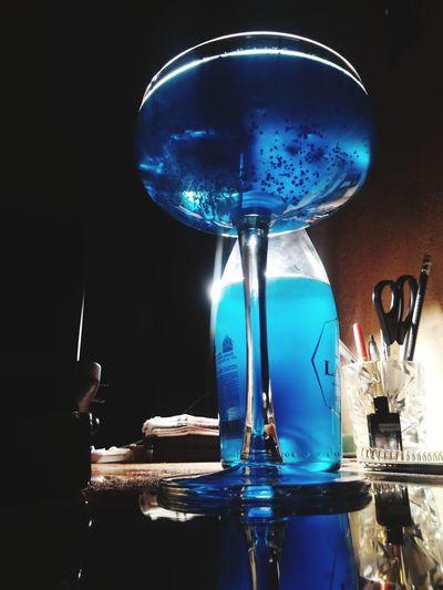 Close-up of wine glass on illuminated table