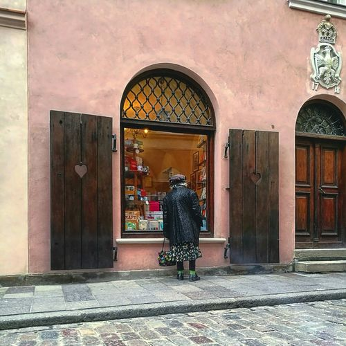 Architecture Built Structure Outdoors One Woman Only Women Day Street Life Streetphotography Oldwoman Green Socks Warsaw Poland Window Shopping Window Arch Stories From The City This Is Aging