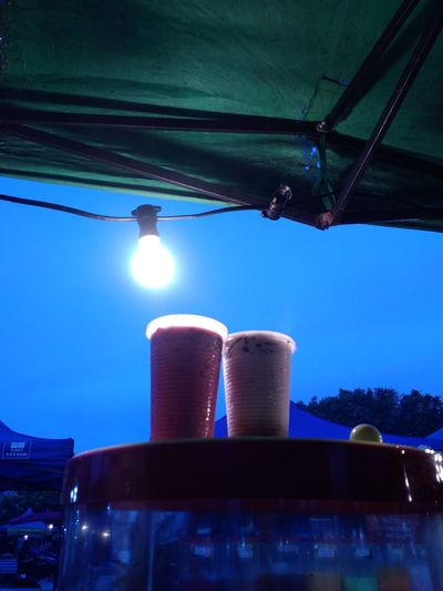Two cup of drink water Shine On ✨ Water Drink No People Sky Landscape Lamplight Cup Colour Of Life Colours Couple Table Food Blue Bright Outdoors Day Freshness