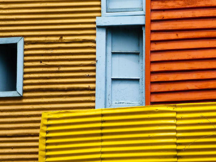 Architecture Building Exterior Yellow Built Structure Day No People Building Window Pattern Closed Wall - Building Feature Outdoors Metal Blue Shutter Full Frame Corrugated Iron Wood - Material Security Iron Corrugated