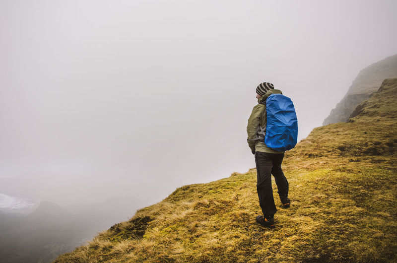 Rear view of a man hiking on mountain