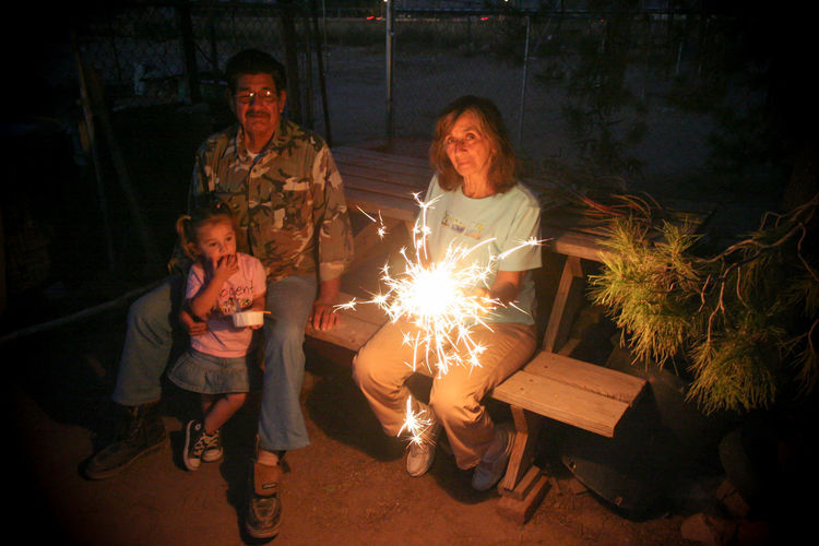 Arizona Casual Clothing Chuck Taylor Converse Family Front View Fun Grandparents Happiness Lifestyles Looking At Camera Night Photography Portrait Real People Sitting Snacking Sparkler Togetherness HUAWEI Photo Award: After Dark