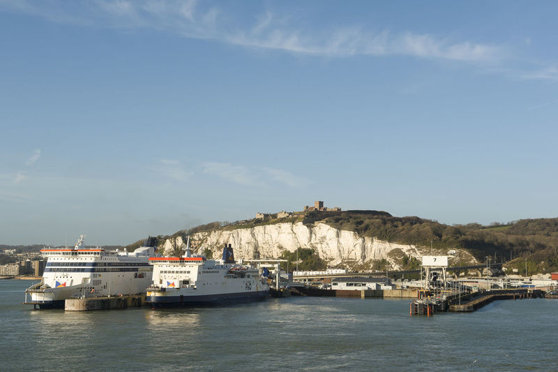 Dover, United Kingdom - December, 18 2017; Port of Dover, with white cliffs and the Dover castle and two ferry ships of P&O lying in the harbour Dover Dover, England White Cliffs  White Cliffs Of Dover Ships Ferryboat Boats Dover Castle Harbour Sky Sea Outdoors Harbor Port