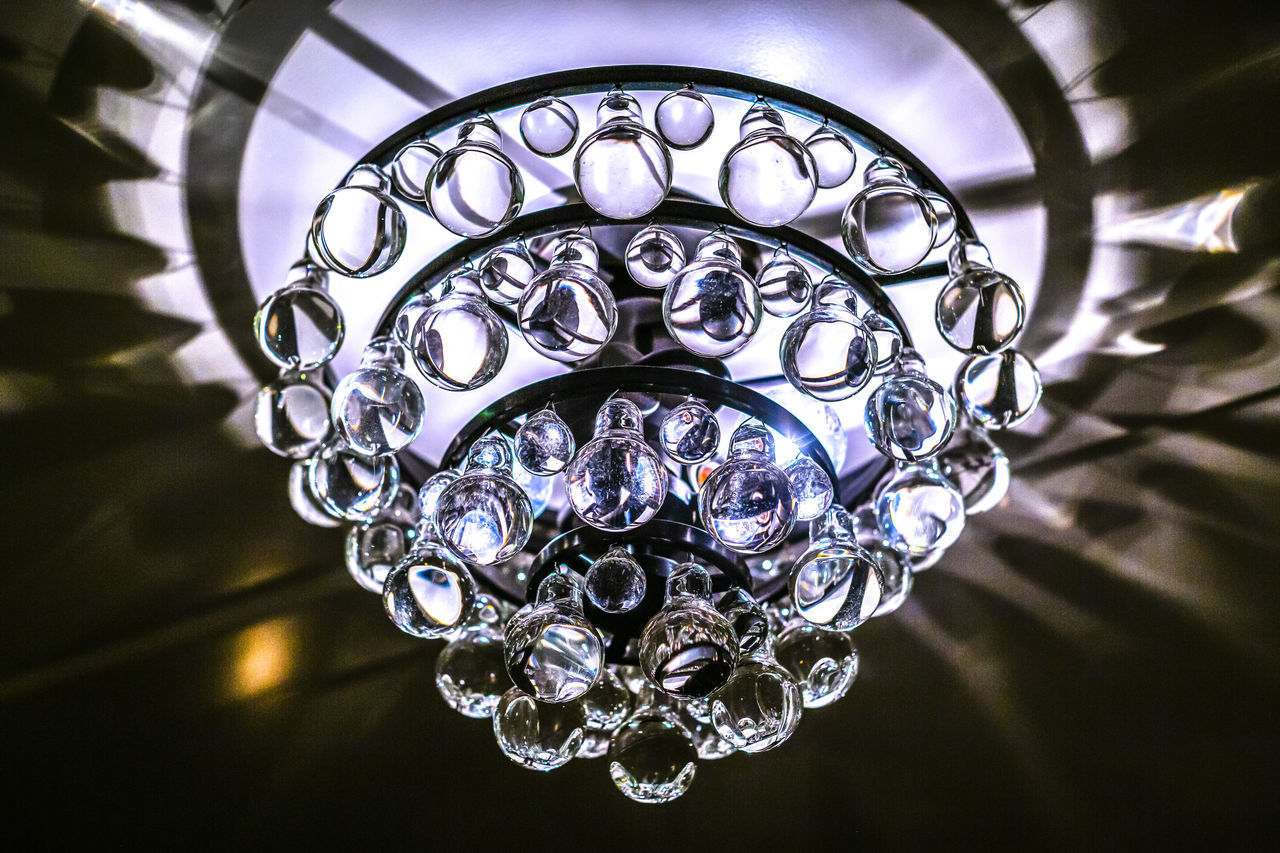 pattern, indoors, close-up, no people, design, luxury, chandelier, wealth, crystal, lighting equipment, decoration, art and craft, focus on foreground, jewelry, shiny, ceiling, low angle view, glass - material, metal, light, ornate, floral pattern, personal accessory